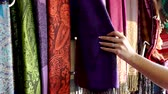 Girl Shopping Inspecting Textiles Central Square Market Stalls Marrakesh Morocco Stok Video