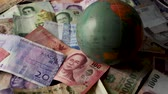 money thai : FHD 59.94FPS footage of Foreign Banknotes Spinning Globe International Finance World Currency Credit Graded Stationary