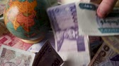 FHD 29.97FPS footage of Foreign Banknotes Grabbing Fist Full World Currency Money Exchange Graded Slow Motion
