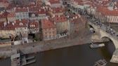 bridge across the river : Prague, Czech Republic - March 9, 2019: Aerial Drone footage of city center buildings and roof tops on the Prague skyline Czech Republic