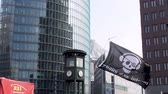 censure : Berlin, Germany - March 23, 2019: Pirate of the Internet flag flying at Demonstration against EU Internet copyright reform  article 11 and article 13 in Berlin Germany