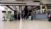passaporte : London, United Kingdom - April 19, 2019: Holiday Makers and tourists passing through security and bag check immigration area