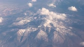 air quality : Mid Flight, United States - April 19, 2019: Window View of flying above the rocky mountains on commercial flight to Las Vegas USA. Stock Footage