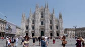 milano : Milan, Italy - June 30, 2019: 4k Slow Motion shot of Tourists visiting the Piazza del Duomo to see top tourist attractions the Duomo del Milano and shopping at Galleria Vittorio Emanuele II Milano