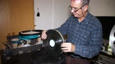 box : Film Technician Checking the Status of the Film.  A technician takes the film reel of his box to check its status. 35mm film cinema technical footage. Film Technician mounting a 35mm film reel in a film festival.