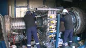 turbofan : Engineers Repairing a Gas Turbine.  Repair and assembly of a turbomachine. Operators working in a gas turbine. Repairmen assembling high technology equipment. Stock Footage
