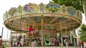 fairgrounds : Pretty Modern Carousel in France.  French style rotating carousel in Carcassonne. Amusement park for children. Fairground in France. Big recreation funfair for kids leisure time.