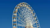 fairgrounds : Great Classical Fair Ferris Wheel In Toulouse.  Ferris wheel on the banks of the Garonne River in Toulouse, France. Fair Ferris Wheel spinning at sunset. Fairground in France. Amusement park for children. Big recreation funfair for kids leisure time. Stock Footage