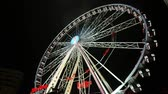 fairgrounds : Great Classical Fair Ferris Wheel In Brussels. Bright Fair Ferris Wheel spinning at night. Fairground in Belgium. Amusement park for children. Big recreation for kids funfair leisure time.