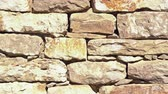stone wall : Close up of old flat brown and gray stone wall texture. Layered rocks on a house or building. Architectural stone wall exterior typical in Bulgaria