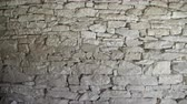 レイヤード : Close up of old flat brown and gray stone wall texture. Layered rocks on a house or building. Architectural stone wall exterior typical in Bulgaria