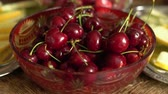 melão : Fresh summer fruits - cherries in vintage crystal bowl on old wooden table