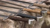 cavaleiro : Medieval weapons replicas for close combat used in wars on display on animal fur Stock Footage