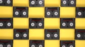 компактный : Vintage mini DV cassette tapes used for filming back in a day. Pattern made of plastic video tapes on yellow background
