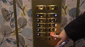 엘리베이터 : Person pressing 1 on hotels elevator. Woman hand pushing elevator button to go down. Holiday traveling