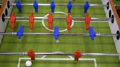 People playing foosball table soccer. Team sport, table football players. Competitive table game