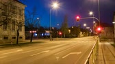 Busy city intersection or crossing with lights and cars at dusk time lapse. Dostupné videozáznamy
