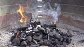 karakalem : Black charcoal burning with smoke and fire in a barbecue grill in slow motion. Delicious meal preparation.