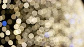 Defocused Christmas or New Years Eve blue and golden lights background. Festive decoration. Dostupné videozáznamy