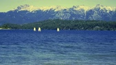 SAILBOATS ON LAKE WITH WOODS AND MOUNTAINS Wideo