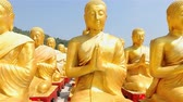 meditation : HD: Dolly: Golden Buddha at Buddha Memorial park , Nakornnayok, Thailand