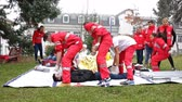 terremoto : Sofia, Bulgaria - December 5, 2015: Volunteers from the Bulgarian Red Cross Youth Organization are participating in a training of saving people from a building during an earthquake.