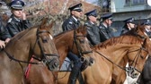 policewoman : Sofia, Bulgaria - March 19, 2016: Policemen and policewomen from Horse police unit are riding the animals while participating in a parade at Saint Theodores day. Zoom out.