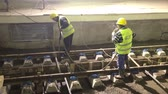 Болгария : Sofia, Bulgaria - April 19, 2016: Underground subway tunnel workers are pouring concrete at the railing tracks of the subway railroad.