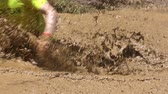 Participants are jumping into muddy water at the Legion Run extreme sport challenge near Sofia. The sports event is mud and obstacle course designed to test peoples physical strength, stamina, and mental grit.