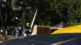 construir : Sofia, Bulgaria - September 24, 2016: An extreme rider is making a free style jump from a ramp. The young boy with his bicycle is seen up in the air near trees. Vídeos