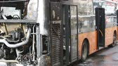 vyhořela : Burnt public traffic bus is seen on the street after caught in fire during travel and extinguished by firefighters. Dostupné videozáznamy
