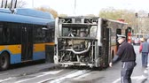 vyhořela : Sofia, Bulgaria - November 8, 2016: Burnt public traffic bus is seen on the street after caught in fire during travel and extinguished by firefighters. Dostupné videozáznamy