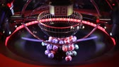 миллионер : Colourful lottery balls in a sphere in motion. Gambling machine and euqipment. Blurred lottery balls in a lotto machine.