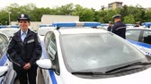 policewoman : Sofia, Bulgaria - 12 May 2017: Police officers stand beside their new patrol cars in the Ministry of the Interior during a ceremony showing the new vehicles. Surveillance and audio recording vehicles.