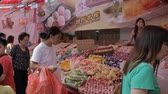 pelúcia : beautiful girl selling in Singapore China Town Stock Footage