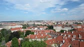 praga : Panning shot of Prague cityscape with Vltava River and rooftops from Prague Castle terrace. Czech Republic.