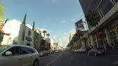 intersection : HOLLYWOOD - CIRCA 2014: POV Driving Down Hollywood Boulevard in Los Angeles on Circa 2014 Stock Footage