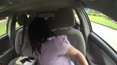 américa latina : Woman fitting clothes in the car of her shopping. Stock Footage