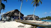 canoe : SAN BLAS, PANAMA, FEB 25: Traditional house Kuna indians with the roof thatched on a islands on the San Blas archipelago in San Blas, Guna Yala, Panama on Feb 25, 2017.