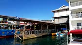 egzotizm : BOCAS DEL TORO, PANAMA, NOV 6, 2017: Shoreline of Bocas Town with hotels, restaurants, and water taxis, Bocas del Toro, Panama in Bocas del Toro, Panama on Nov 6, 2017. Stok Video