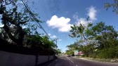 main street : POV of Famous Bay Street neighborhood in Downtown Nassau of The Bahamas Stock Footage