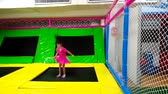 Girl jumping in kids play room.