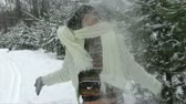 beauty female face : Mature woman playing with snow Stock Footage