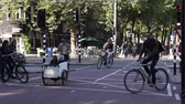 j��zda na kole : AMSTERDAM AUGUST 29: Cyclists ride on the street on August 29 2014 in Amsterdam.