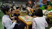 november : Moscow, Russia - November 19, 2016: People playing table game at the Gamefilmexpo festival dedicated to video games, TV series and comics, anime, manga, cosplay.