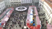 november : Bratislava, Slovakia - November 26, 2016: Christmas fair top view from city hall tower at day time Stock Footage