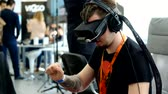 questões : Moscow, Russia - June 8, 2017: VR conference visitor tests virtual reality helmet