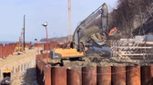 madencilik : Svetlogorsk, Russia - April 17, 2018: Excavator works on the seashore, strengthening the Baltic Sea coastline, building a new promenade