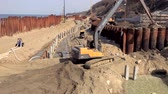 madencilik : Svetlogorsk, Russia - April 17, 2018: Excavator works on the seashore, strengthening the Baltic Sea coastline, building a new promenade for the 2018 FIFA World Cup