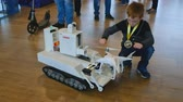 robótico : Moscow, Russia - April 24, 2018: Boy meets robotics innovations at Skolkovo Robotics Forum Vídeos